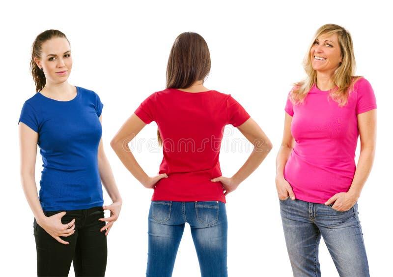Tres mujeres con las camisas en blanco fotografía de archivo