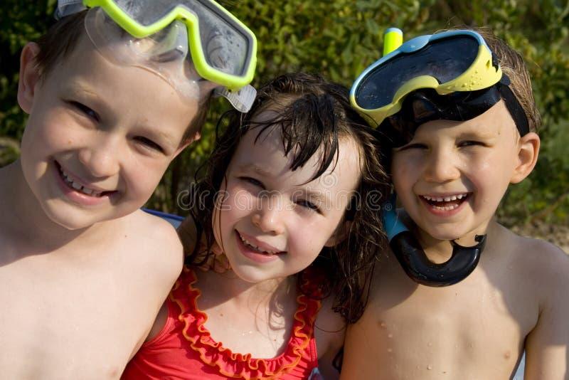 Tres nadadores jovenes imagen de archivo