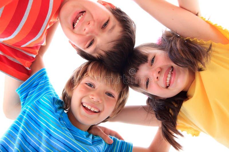 Tres niños felices imagen de archivo libre de regalías