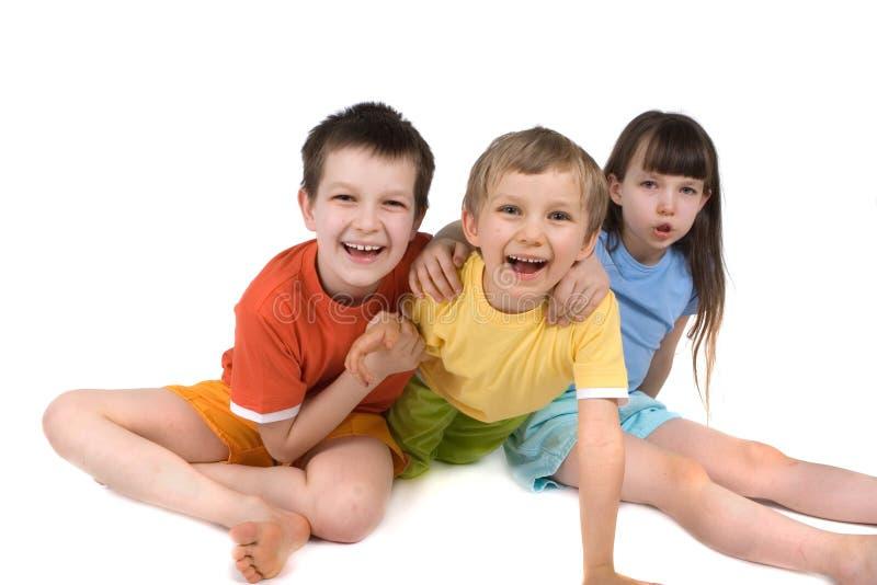 Tres niños felices imagen de archivo