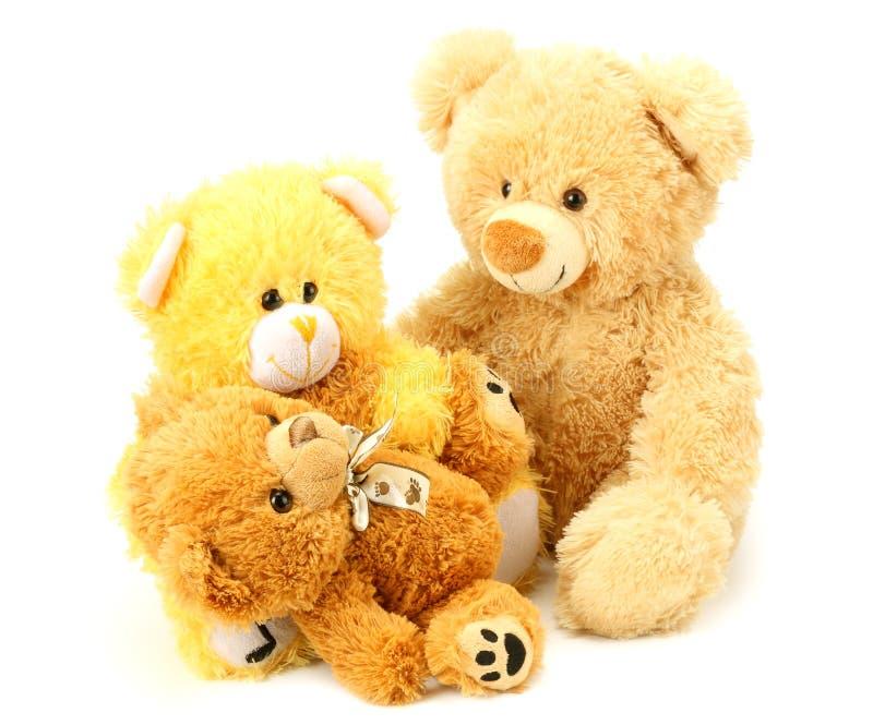 Tres osos de peluche del juguete aislados en el fondo blanco imagen de archivo libre de regalías