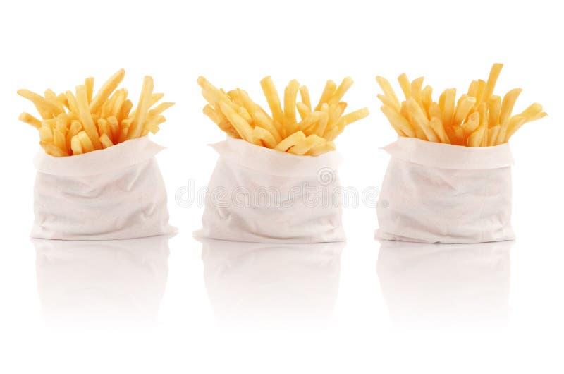 Tres paquetes de patatas fritas foto de archivo libre de regalías