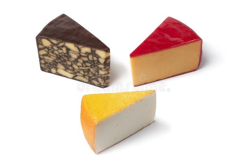 Tres pedazos de diverso queso foto de archivo