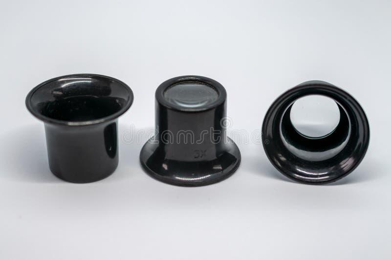 Tres pedazos negros del ojo que magnifican fotografía de archivo