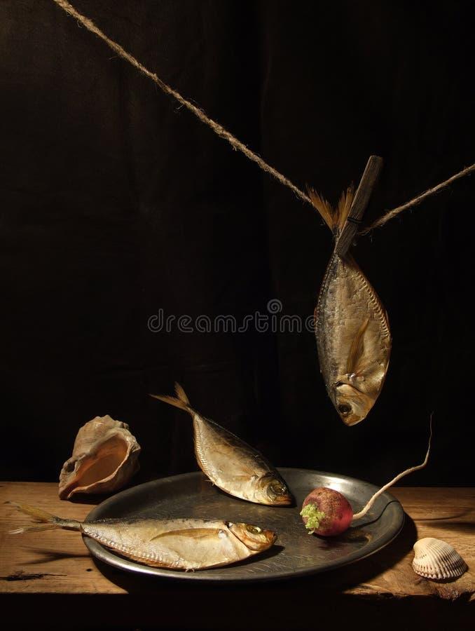 Tres pescados con el rábano imágenes de archivo libres de regalías