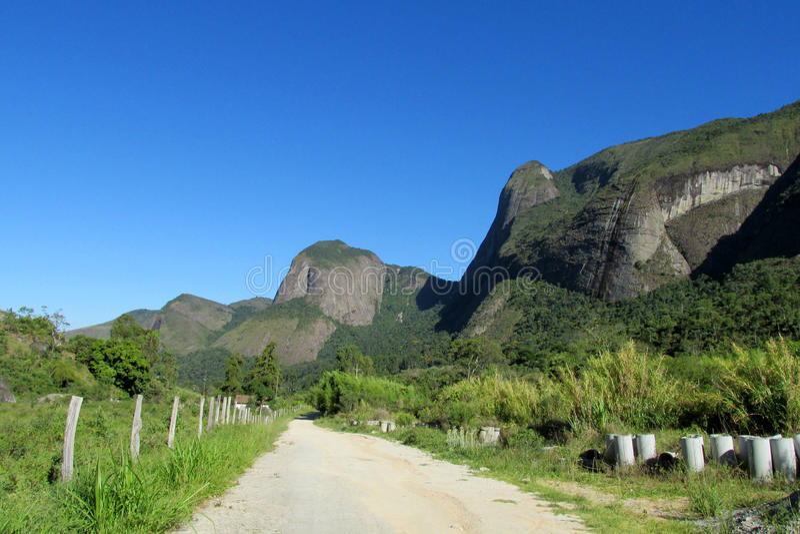 Tres Picos National Park, Brazil. Tres Picos, three peaks isolate mountain ofSerra dos Orgaos National Park located in Nova Friburgo town, Rio de Janeiro royalty free stock photos