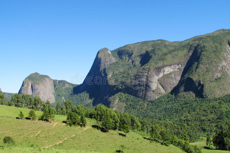 Tres Picos National Park green valley. Tres Picos, three peaks isolate mountain ofSerra dos Orgaos National Park a great stone wall to climb, verticals royalty free stock photo