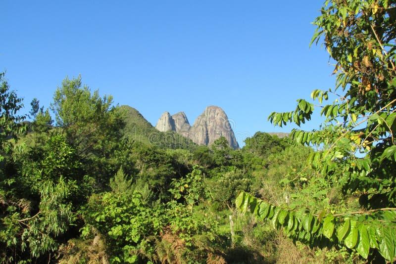 Tres Picos Park, Atlantic Rainforest, Brazil. Tres Picos, three peaks isolate mountain ofSerra dos Orgaos National Park a great stone wall to climb stock image