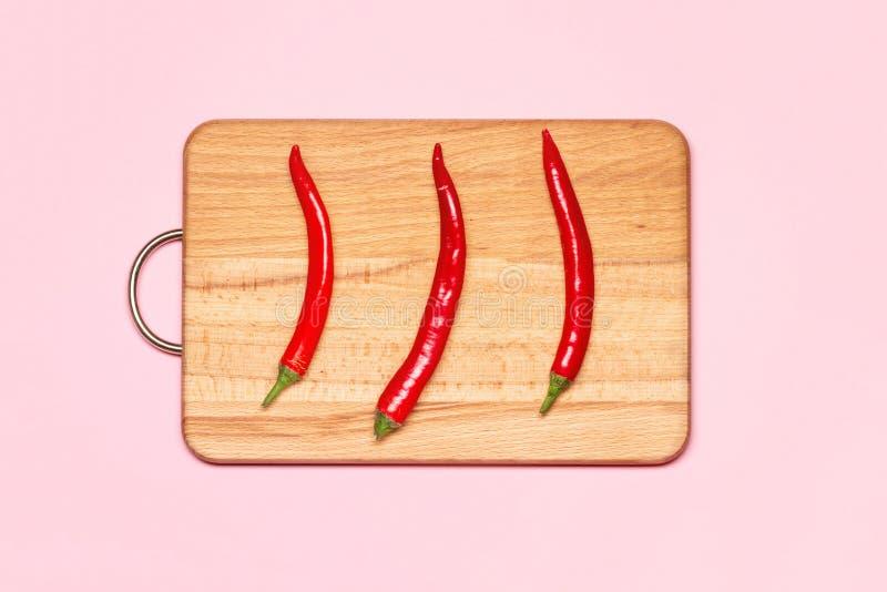Tres pimientas de chiles rojos frescas imagen de archivo libre de regalías