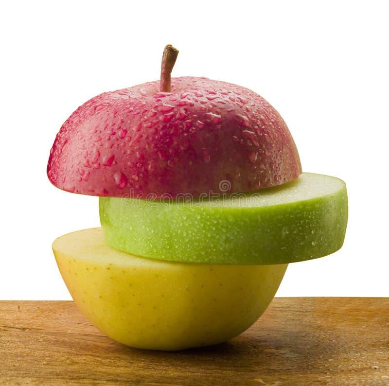 Tres rebanadas de manzanas imagenes de archivo