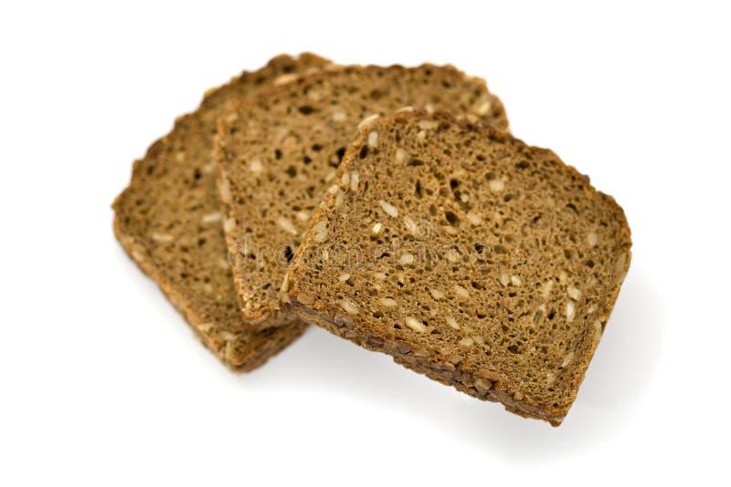 Tres rebanadas de pan entero del grano imágenes de archivo libres de regalías