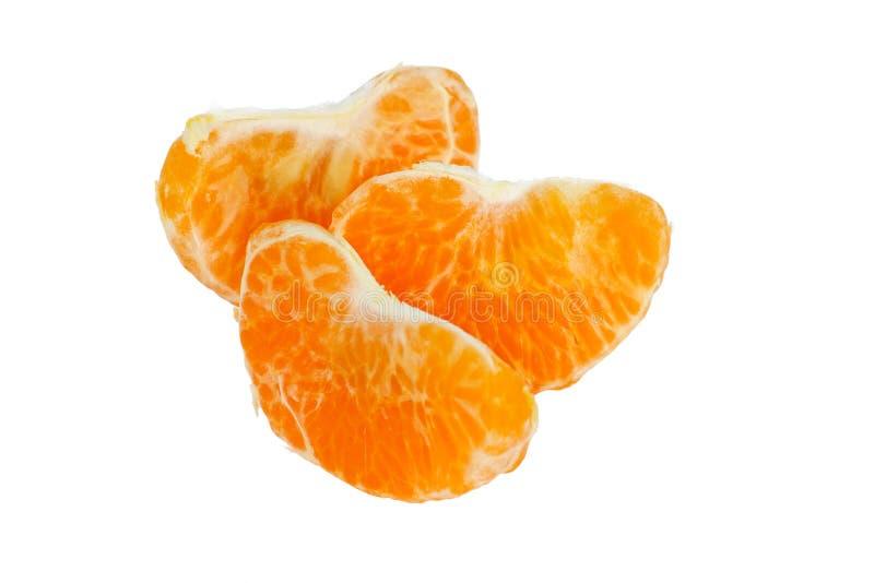 Tres rebanadas frescas de la mandarina fotos de archivo libres de regalías