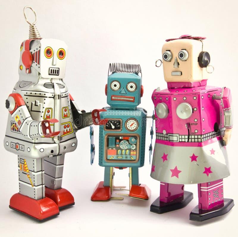 Tres robots retros del juguete junto imágenes de archivo libres de regalías