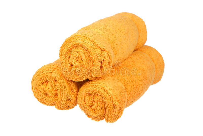 Tres rodillos anaranjados de las toallas imagenes de archivo