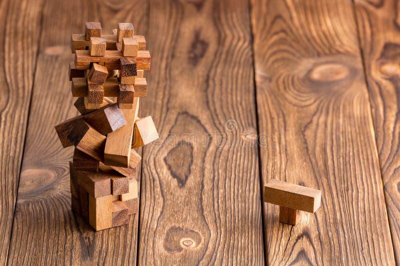 Tres rompecabezas de madera entrelazados complejo fotos de archivo libres de regalías