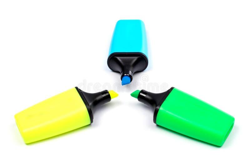 Tres rotuladores coloreados imagenes de archivo