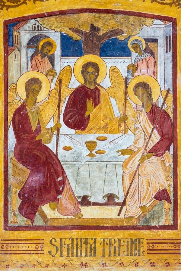 Tres santos en uno fotos de archivo