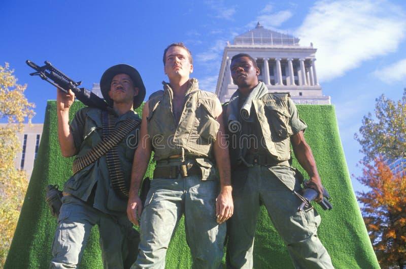Tres soldados en un flotador imagen de archivo libre de regalías