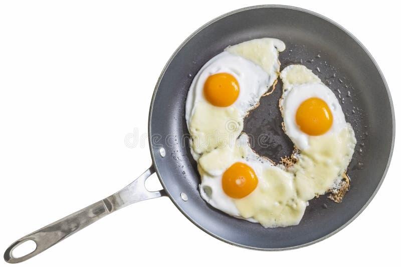 Tres Sunny Side Up Fried Eggs con las rebanadas del queso del queso Edam imagenes de archivo