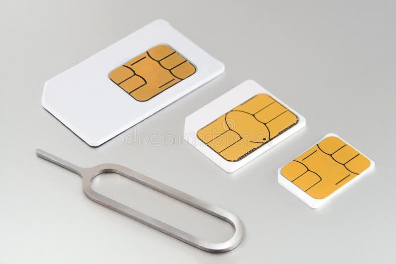 Tres tarjetas del sim fotos de archivo libres de regalías
