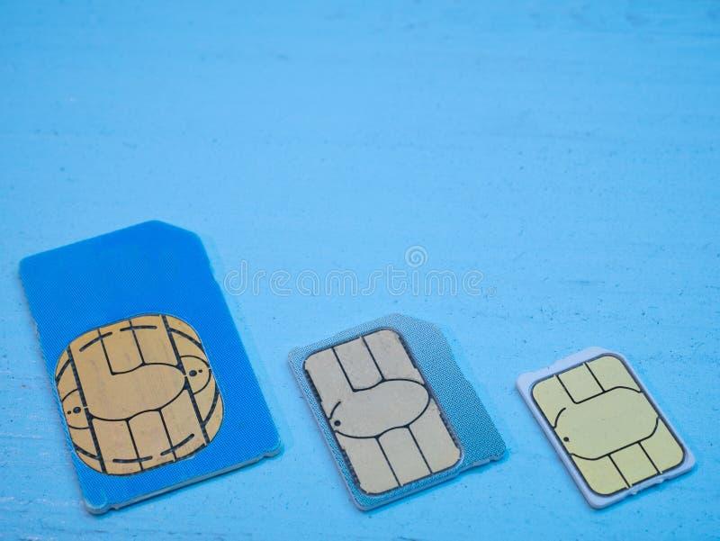Tres tarjetas estándar, micrófono, 5g nano del sim listo imagen de archivo libre de regalías