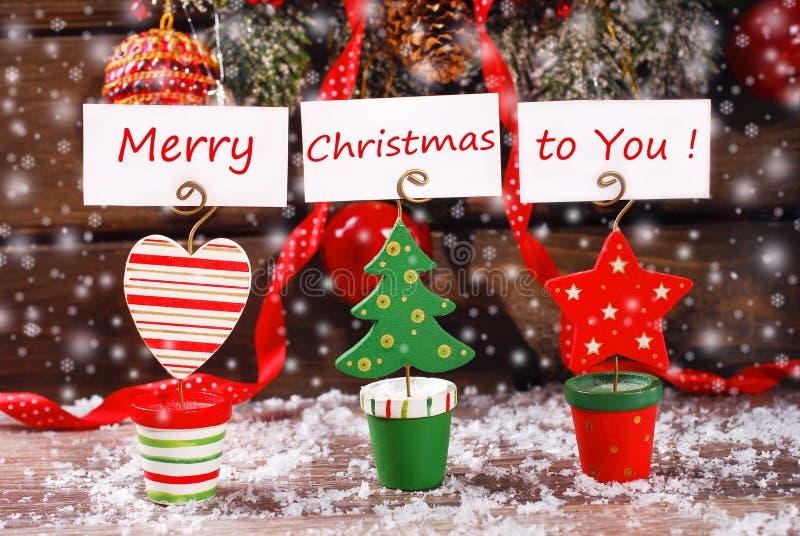 Tres tenedores de la tarjeta de felicitación de la Navidad en la tabla de madera fotos de archivo libres de regalías