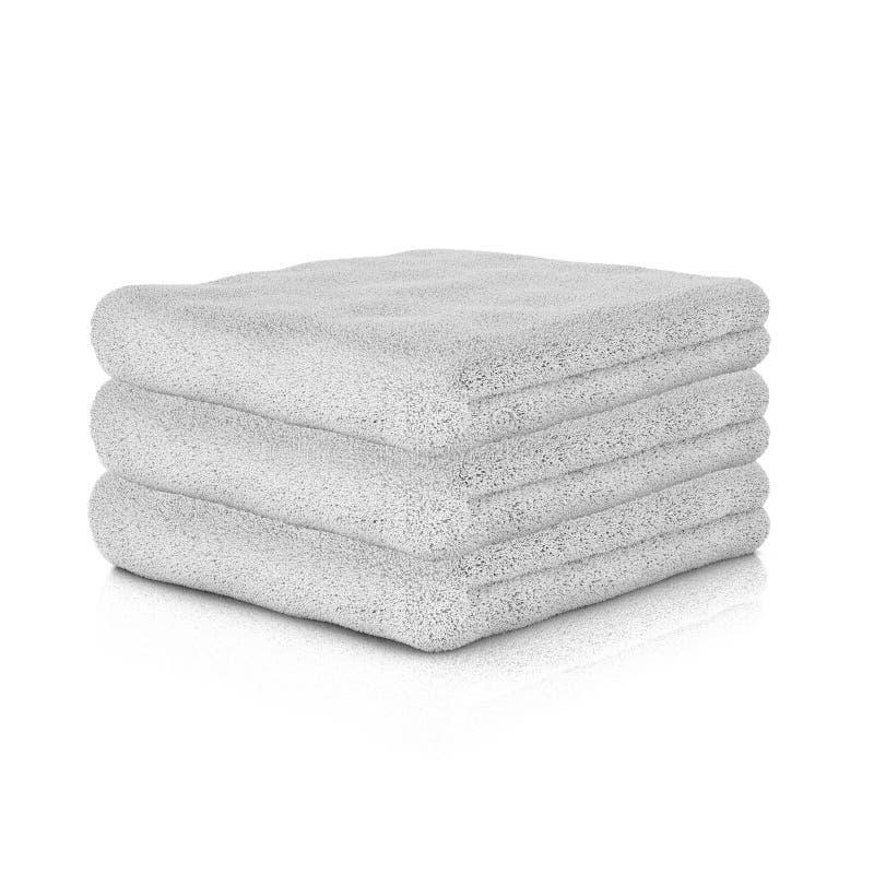 Tres toallas dobladas blanco ilustración del vector