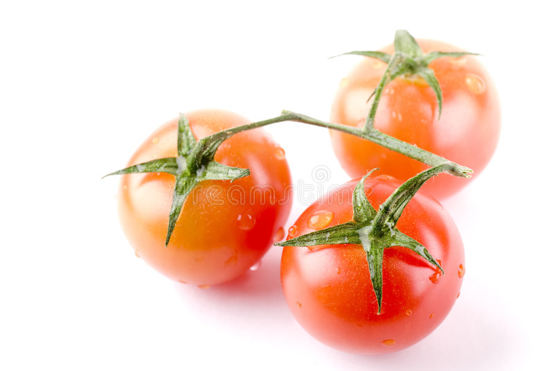 Tres tomates imagen de archivo