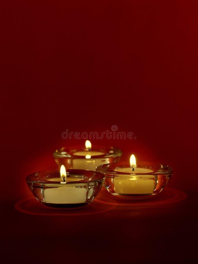 Tres velas imagen de archivo