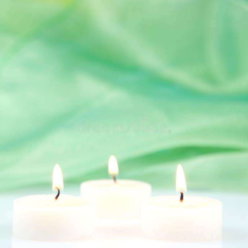 Tres velas ardientes imagen de archivo libre de regalías