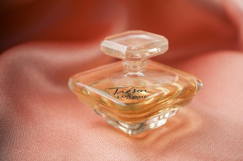 Tresor de Lancome bottle of perfume on satin background stock photos