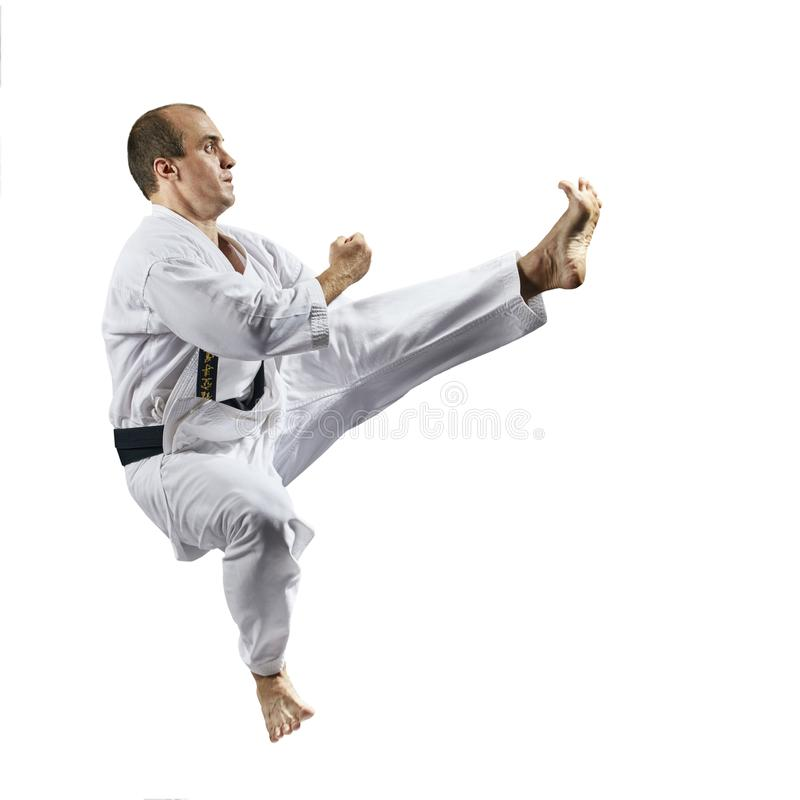 Treten vorwärts in einen Sprung in der Leistung eines Athleten im karategi Kaderov lizenzfreies stockfoto