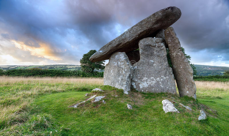 Trethevy Quoit. Under a moody sky on Bodmin Moor in Cornwall, an impressive Neolithic dolmen burial chamber that stands nearly nine feet tall stock photos