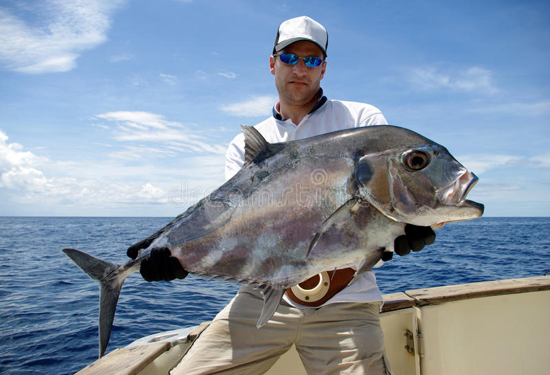 Trevally jack. Big game fishing. a fisherman holding a trevally jack stock photography