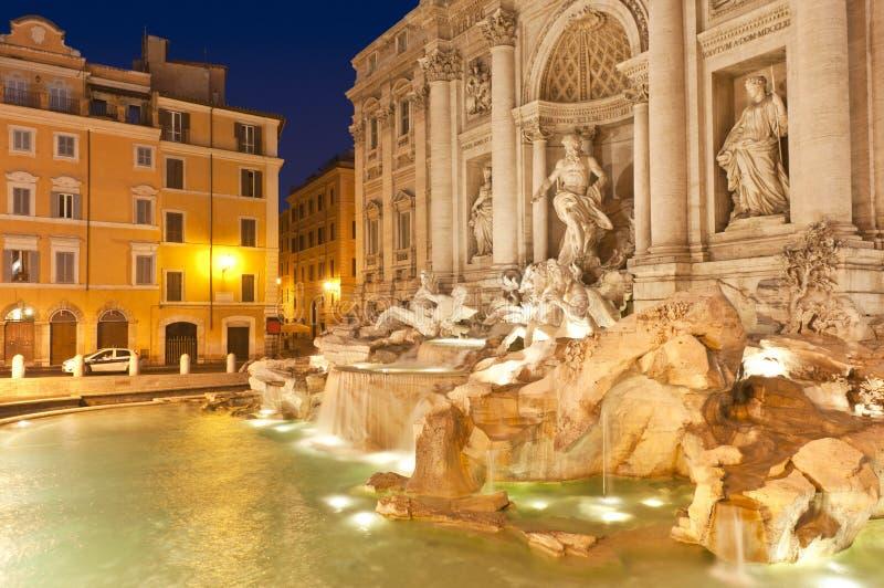 Trevi Fountain, Rome. Stunningly ornate Trevi Fountain (1762) illuminated at night in the heart of Rome royalty free stock photo