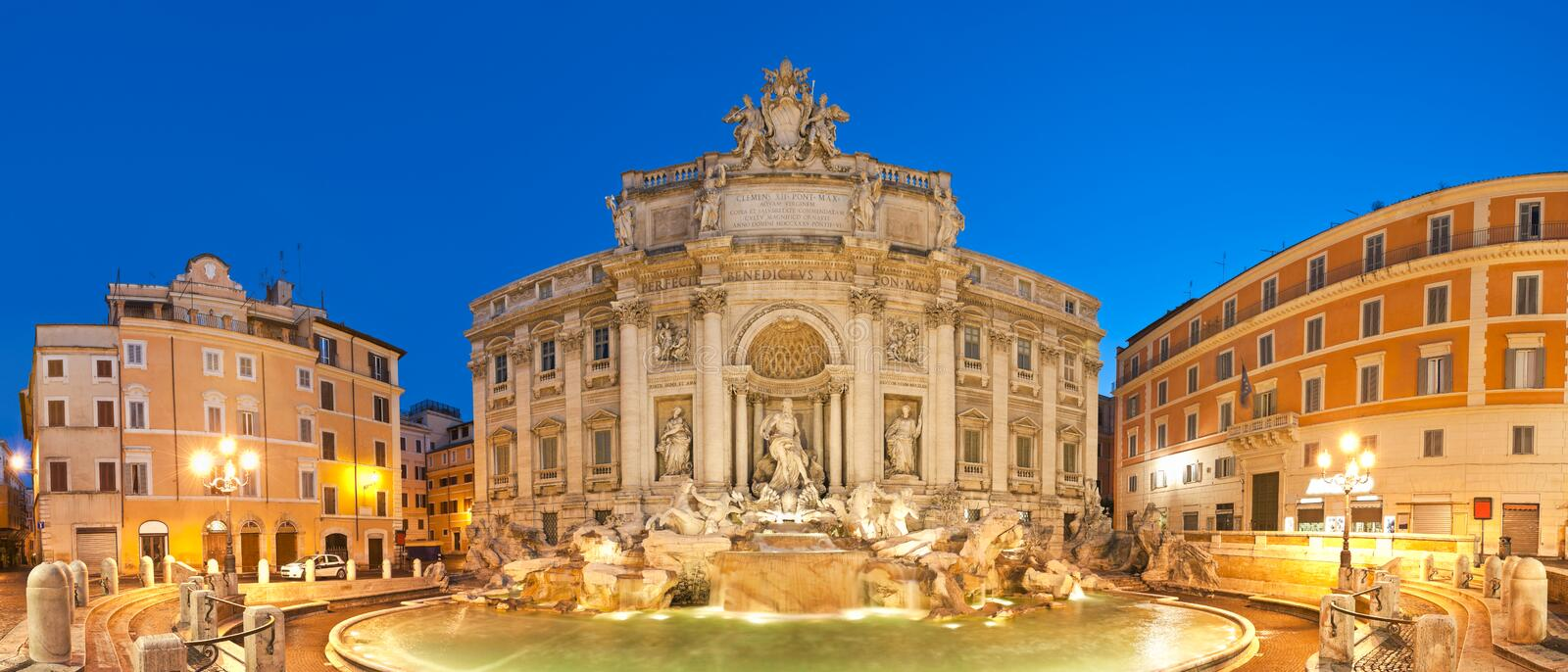 Trevi Fountain, Rome. Stunningly ornate Trevi Fountain (1762) illuminated at night in the heart of Rome. Stitched panoramic image stock images