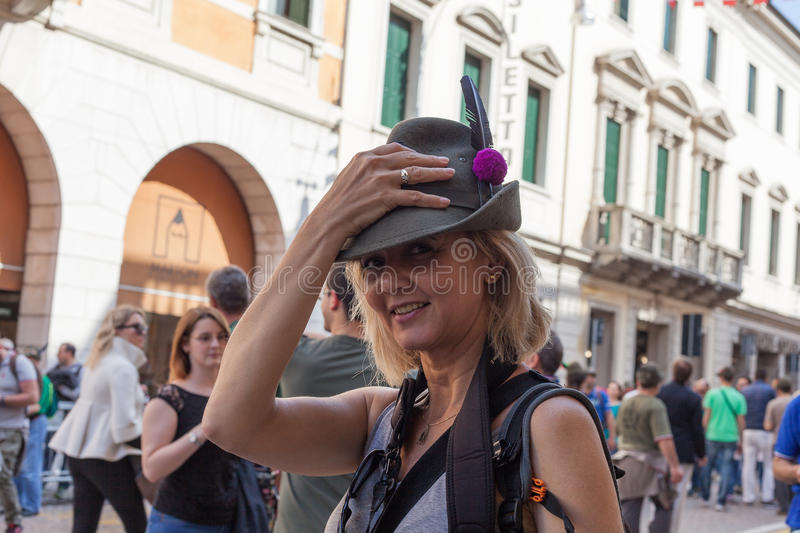 TREVISO, ITALY - MAY 13: national assembly of the italian veterans alpine troops. 13 and 14 may 2017. Young woman with military hat stock photography
