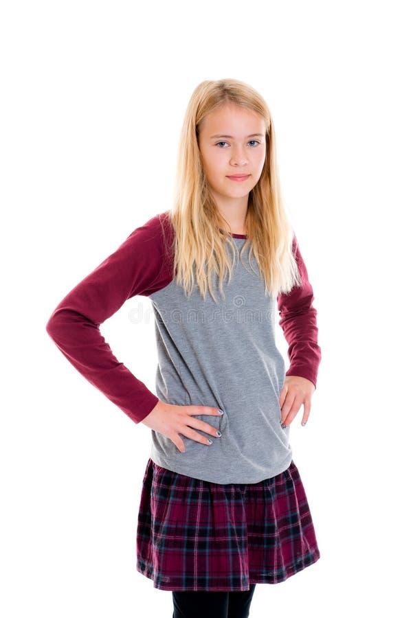 Trevlig blond flicka i plädkjol fotografering för bildbyråer
