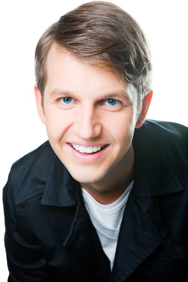 trevligt leende för älskvärd man för blåa ögon royaltyfria bilder