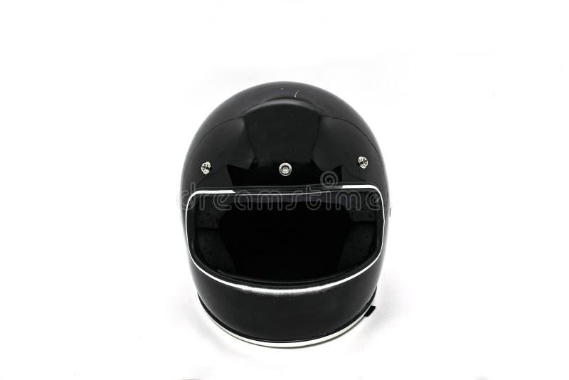Trevligt perspektiv av en motorcykelhjälm som isoleras i vit bakgrund arkivfoto