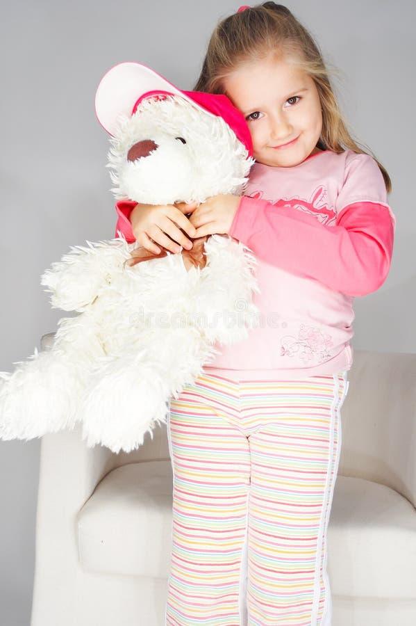 trevligt rosa barn för bakgrundsflickalampa fotografering för bildbyråer
