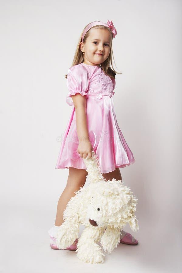 trevligt rosa barn för flicka arkivfoton