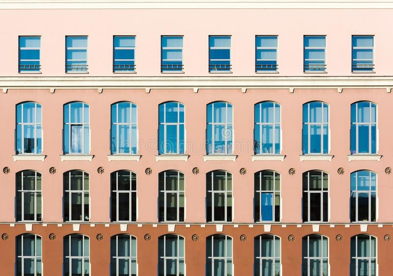 Tri-color facade with high windows. Architectural details. Of the city royalty free stock image