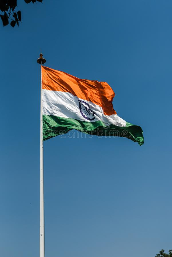 Tri-color National Flag of India. Tri-color Indian National Flag waving at New Delhi royalty free stock photo