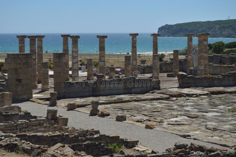 Triada Capitolina tempel i Roman City Baelo Claudia Dating i det 2nd ?rhundradet F. KR. Lagerf?ra fotoet, bilden och den fria bil arkivbild