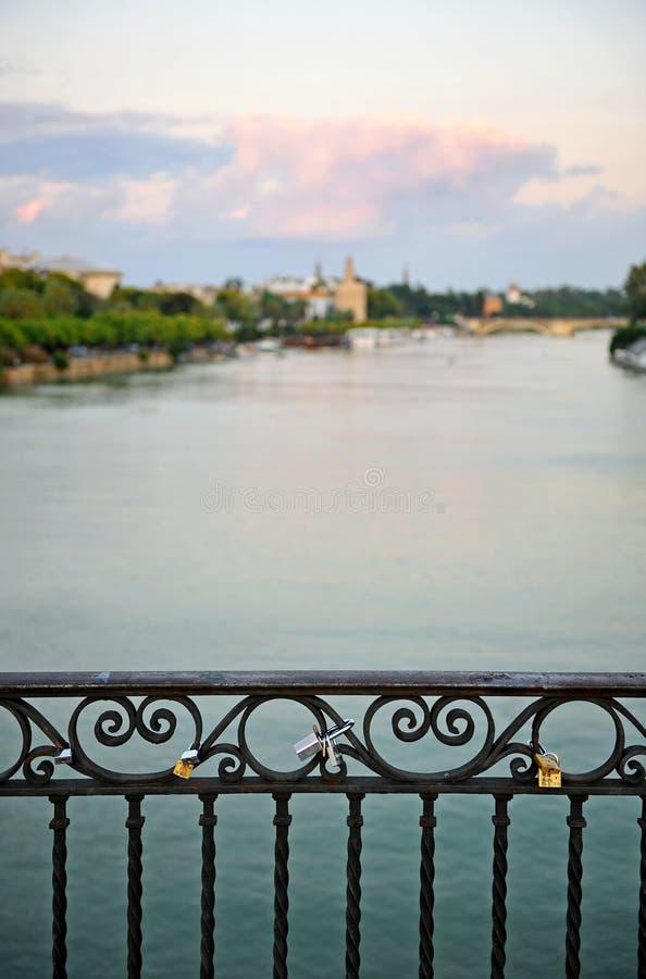 Triana bridge over the Guadalquivir River, Seville, Andalusia, Spain. One of the bridges that connect the two banks of the Guadalquivir river as it passes stock image