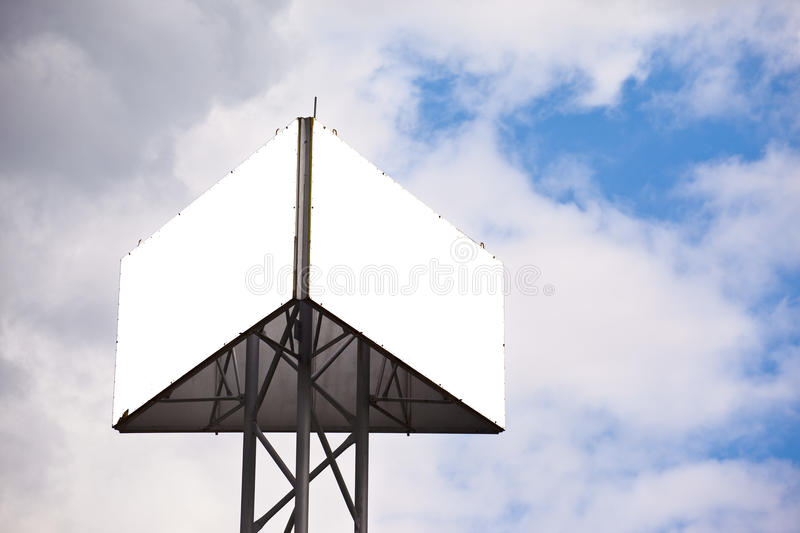 Triangle billboard. Blank sides of a triangular billboard on blue sky with clouds royalty free stock photography