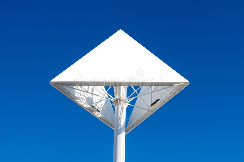 Triangle billboard or advertising poster with blue sky background. Mock up. Triangle billboard or advertising poster with blue sky background stock images