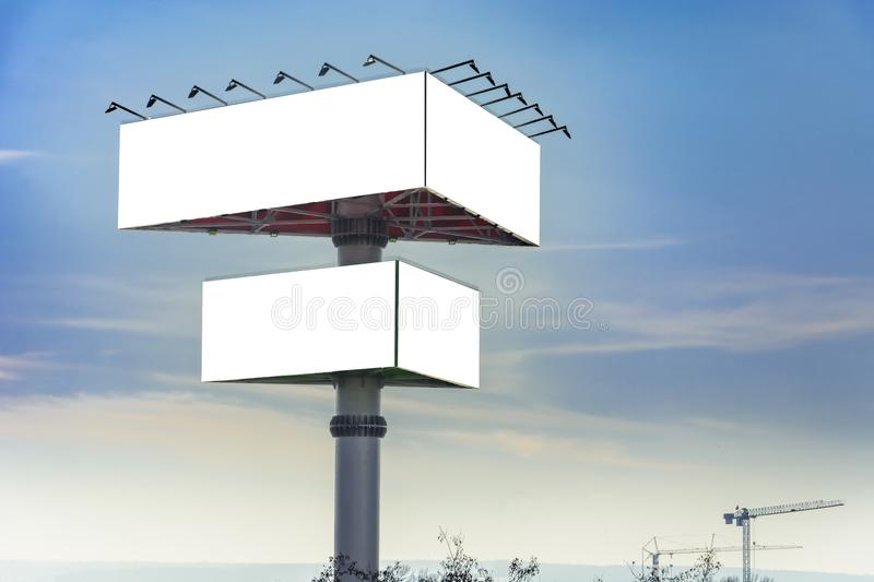 Triangle billboard. Against blue sky, Place for text stock photography