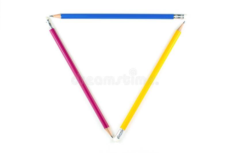 Triangle de crayon principal de couleur sur le fond blanc photo libre de droits